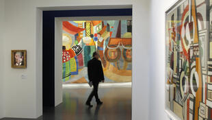 A visitor admiring art at the Metz Pompidou Centre