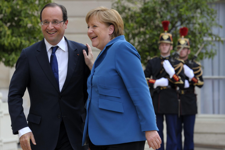 François Hollande with Angela Merkel, at the Elysée palace Wednesday