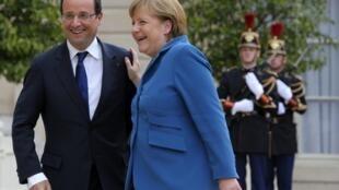 Le président français François Hollande et la chancelière allemande Angela Merkel, à l'Elysée, le 27 juin 2012.