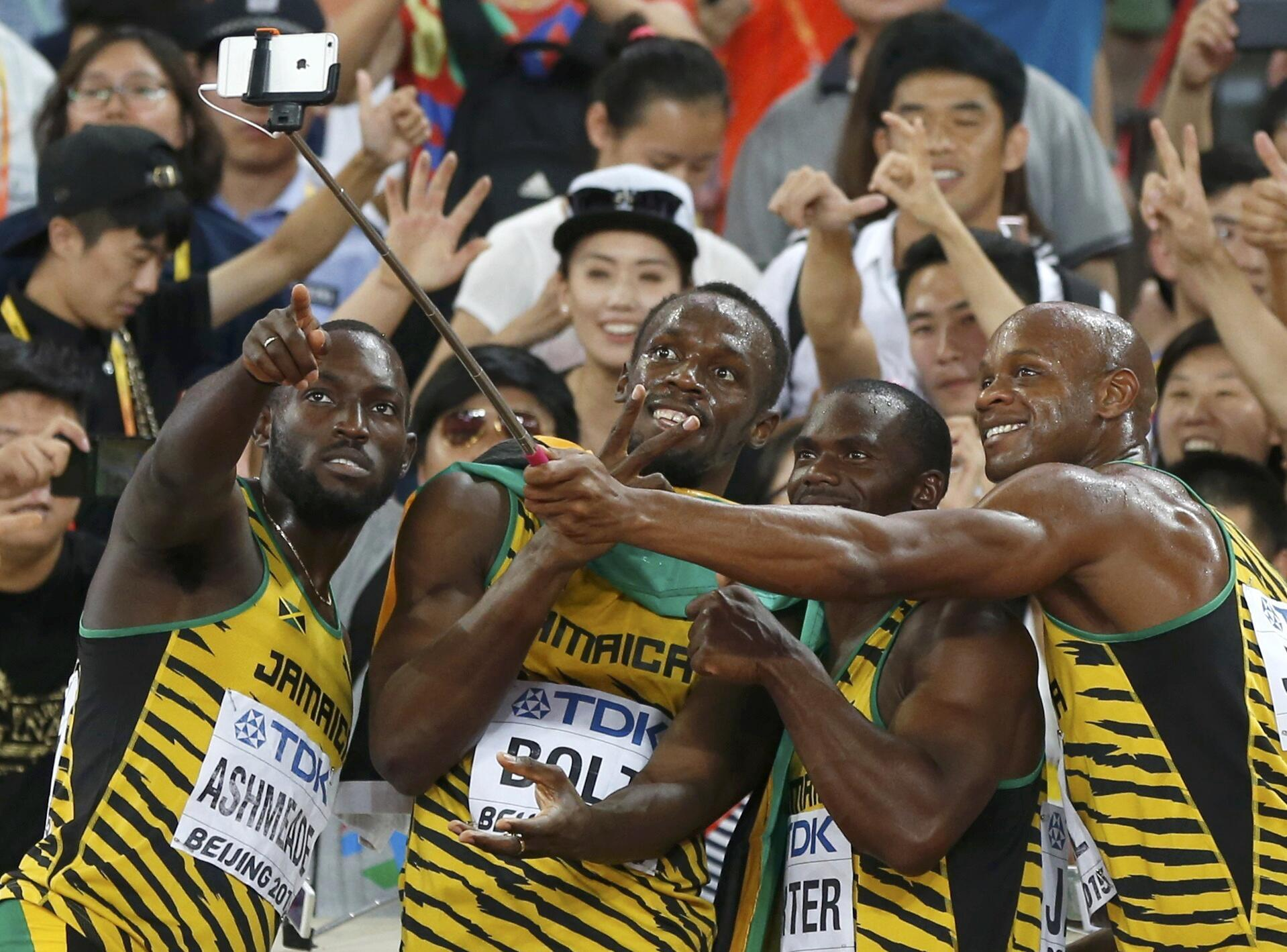 (L to R) Nickel Ashmeade, Usain Bolt, Nesta Carter and Asafa Powell of Jamaica pose for selfies after winning gold at the men's 4 x 100 metres relay final