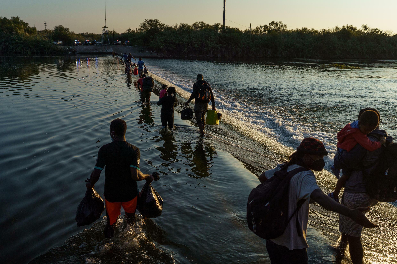 Haitian migrants cross the Rio Grande near the Del Rio-Acuña Port of Entry in Ciudad Acuña, Mexico