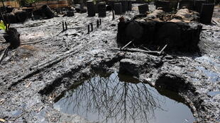 Oil pollution contaminates the water and the land in the Niger Delta, Nigeria