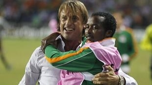 Zambia's head coach Herve Renard celebrates as he carries Joseph Musonda after their victory against Côte d'Ivoire in February 2012
