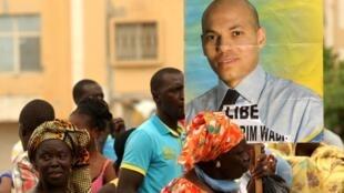 Manifestation en soutien à Karim Wade, à Dakar, le 8 octobre 2013 (illustration).