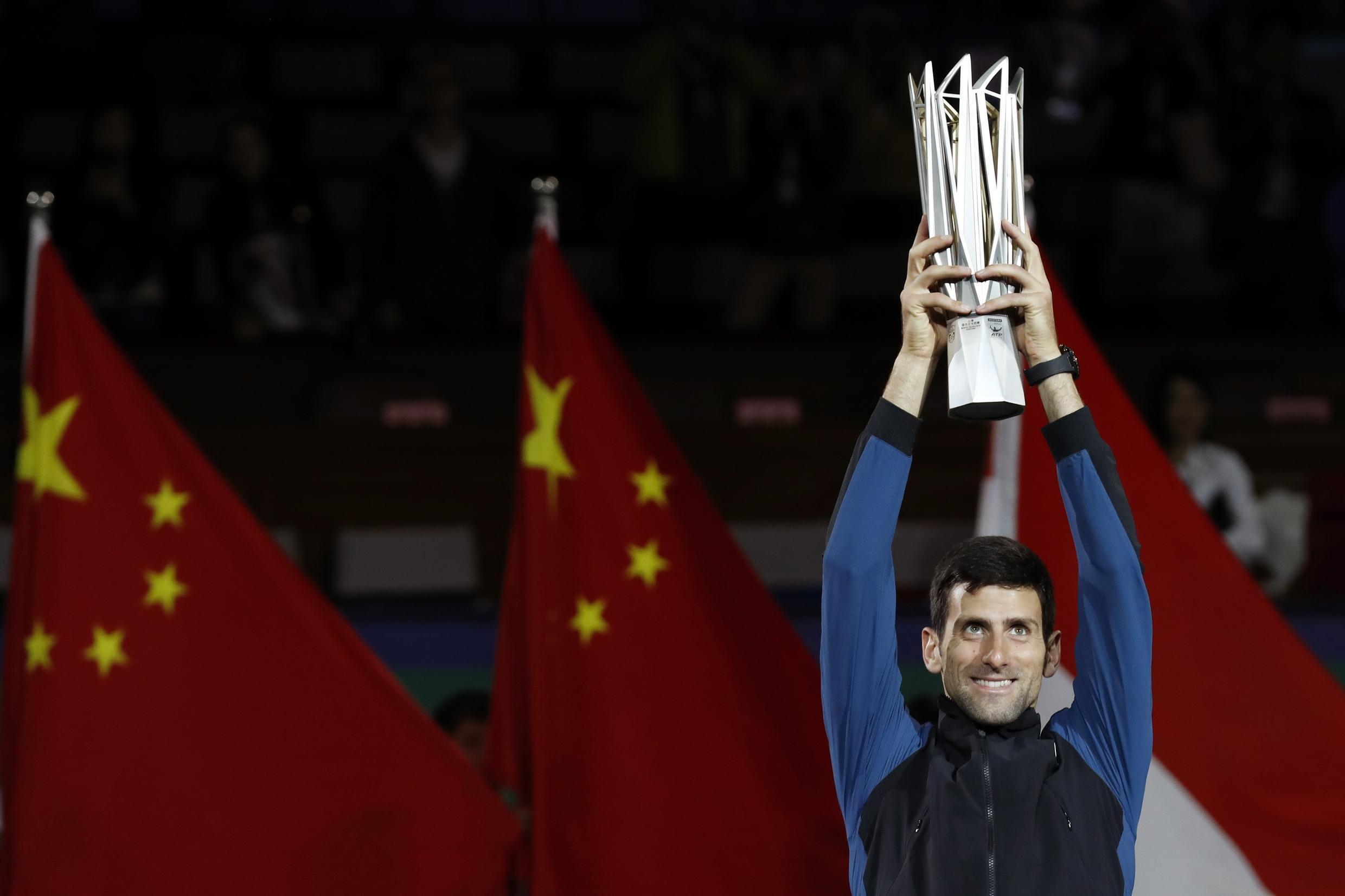 Novak Djokovic won his fourth Shanghai Masters title with a straight sets win over Borna Coric.