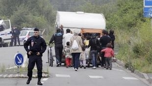 Police clear a Roma camp