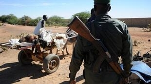 The body of the Gao suicide bomber is pulled away on a cart