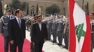 Lebanon's Prime Minister Al-Hariri and Ahmadinejad review a guard of honour at the government palace in Beirut