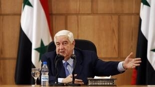 Syrian Foreign Minister Walid al-Moualem talks during a news conference in Damascus 24 January