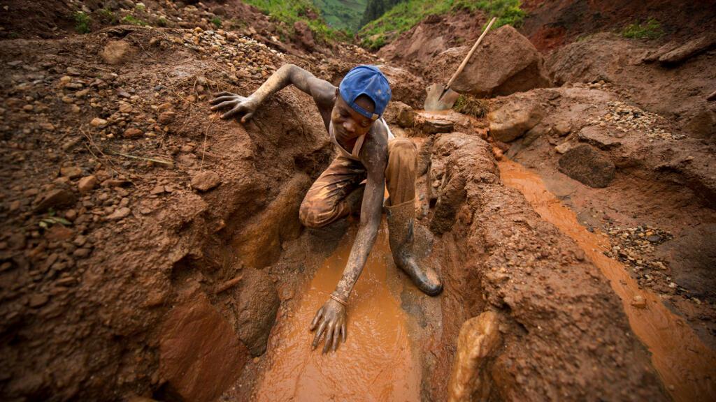 Artisanal miners work at extracting coltan from the valley below Senator Edouard Mwangachuchu's mine in the Masisi territory in North Kivu, Democratic Republic of Congo.
