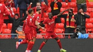 Pointing towards the Champions League: Sadio Mane (right)scored the goals that secured Liverpool a top-four finish