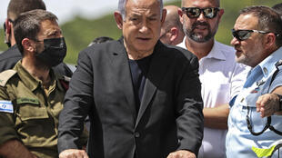 Israeli Prime Minister Benjamin Netanyahu visits the site of a deadly overnight stampede during an ultra-Orthodox Jewish religious gathering in the northern town of Meron,