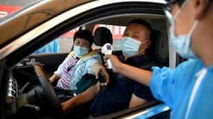 China was conducting mass tests after an outbreak of the virus in Beijing