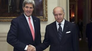 French Foreign Affairs Minster Laurent Fabius with US Secretary of State John Kerry.