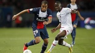 Lucas Moura, médio brasileiro do Paris Saint-Germain (na esquerda).