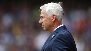 Alan Pardew says he is flattered to be linked with the vacant post of England manager.