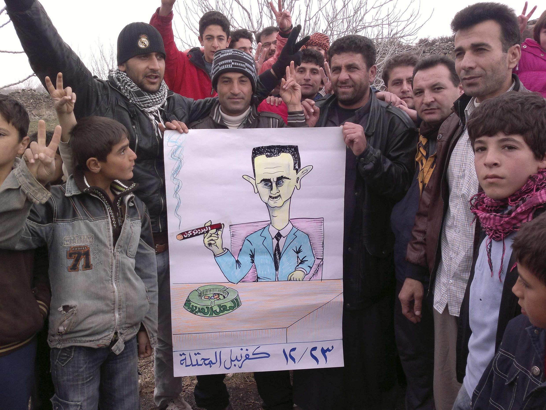 Demonstrators protest against Syria's President Bashar al-Assad after Friday prayers in Kafranbel