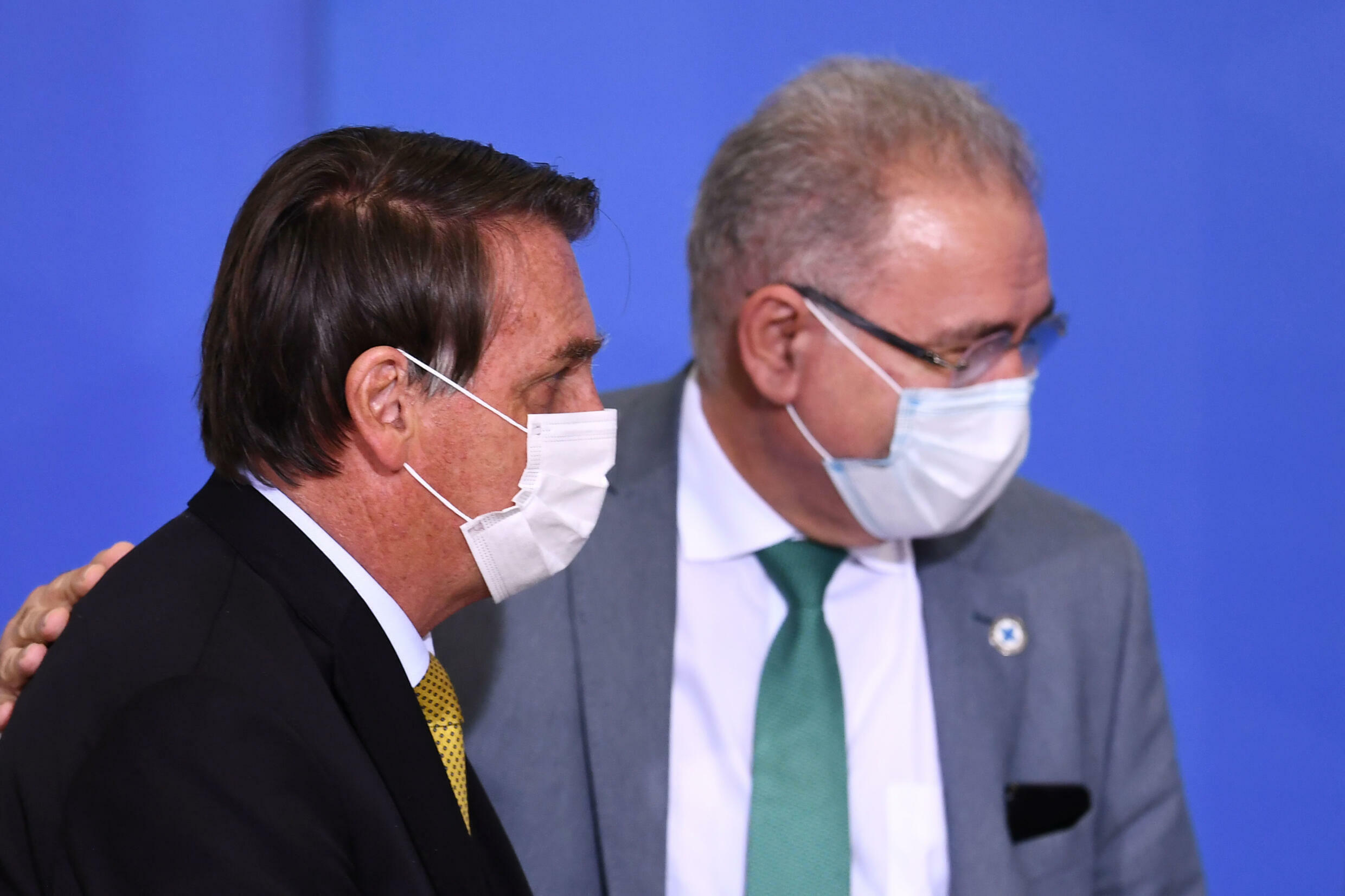 Brazilian Health Minister Marcelo Queiroga (R) with President Jair Bolsonaro (L) at an event in Brasilia on June 29, 2021. The health minister has tested positive during a meeting of the Un General Assembly in New York