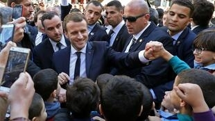 French President Emmanuel Macron meets the people in Algiers on Wednesday