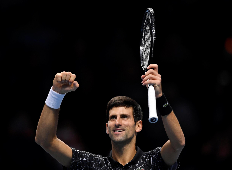 Tennis - ATP Finals - The O2, London, Britain - November 12, 2018 Serbia's Novak Djokovic celebrates winning his group stage match against John Isner of the U.S.