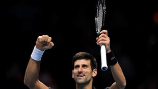 Tennis - ATP Finals - The O2, London, Britain - November 12, 2018 Serbia's Novak Djokovic celebrates winning his group stage match against John Isner of the U.S.