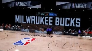 Referees huddled at the edge of an empty court Wednesday as the Milwaukee Bucks and Orlando Magic did not arrive for the scheduled start of their NBA playoff contest