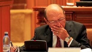 Romania's President Traian Basescu takes notes before the Parliament vote on suspending him over what the ruling Social Liberal Union (USL) says is his attempt to pressure judges and break the constitution, in Bucharest July 6, 2012.