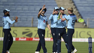 England celebrate after taking the wicket of India's Rishabh Pant