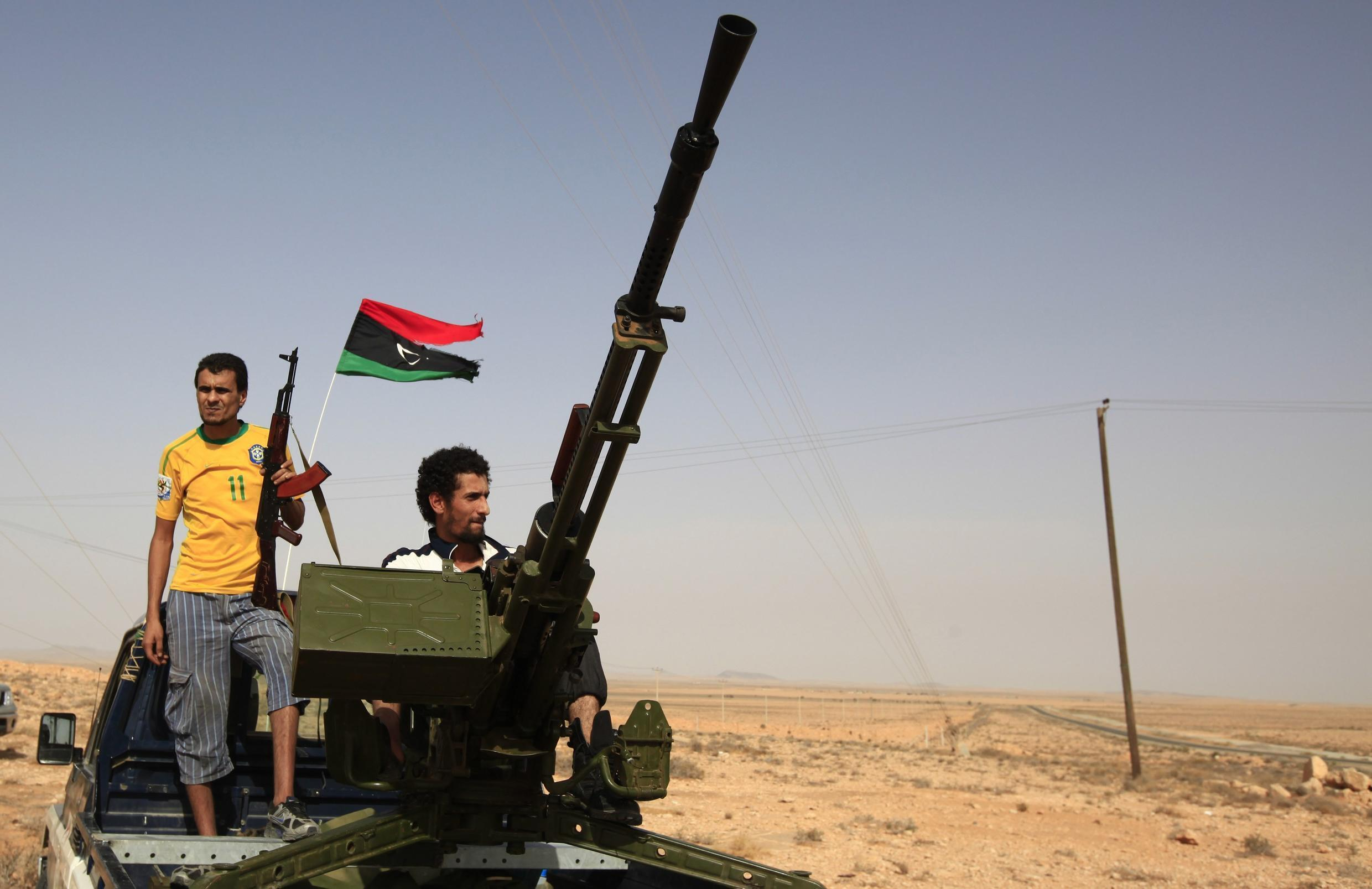 Lilbyan fighters wait in the outskirts of the town of Bani Walid