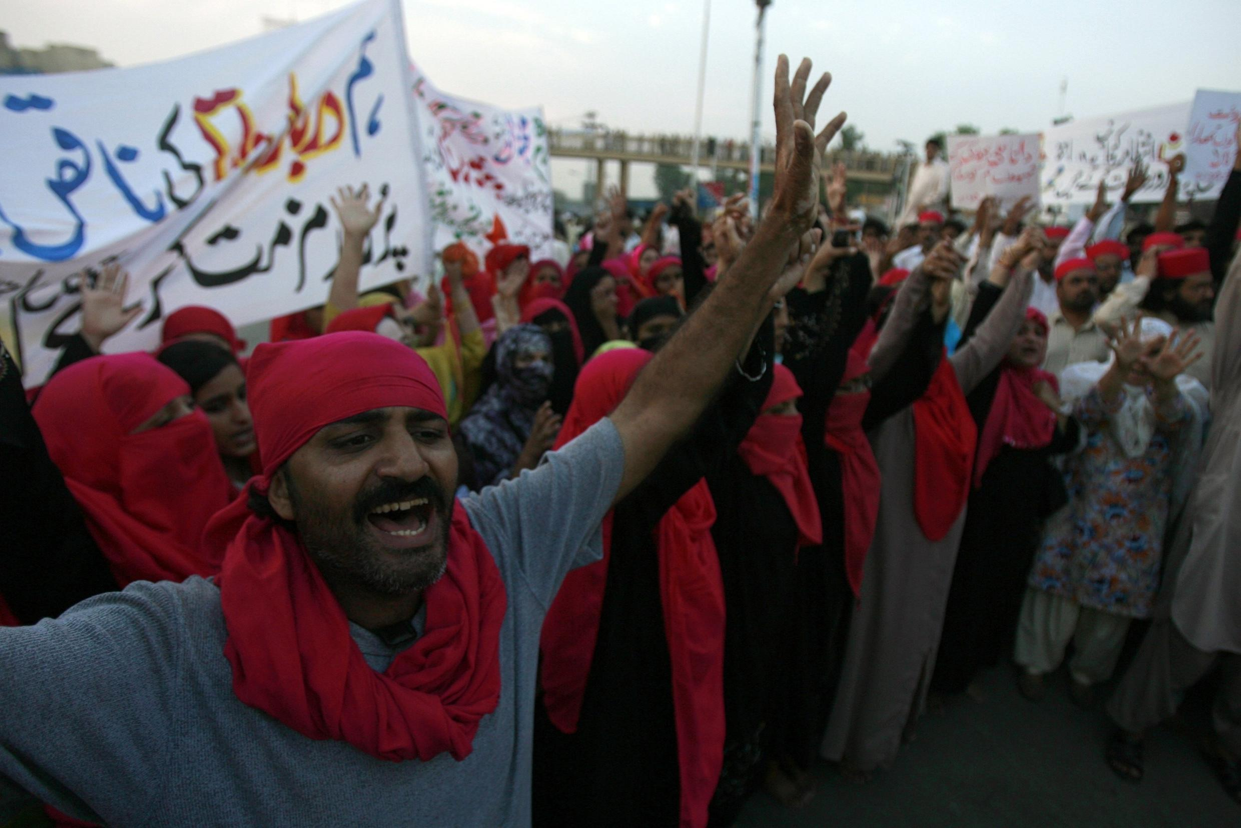 People march through the streets of Lahore to condemn the multiple suicide bomb attacks at the Data Darbar Sufi shrine