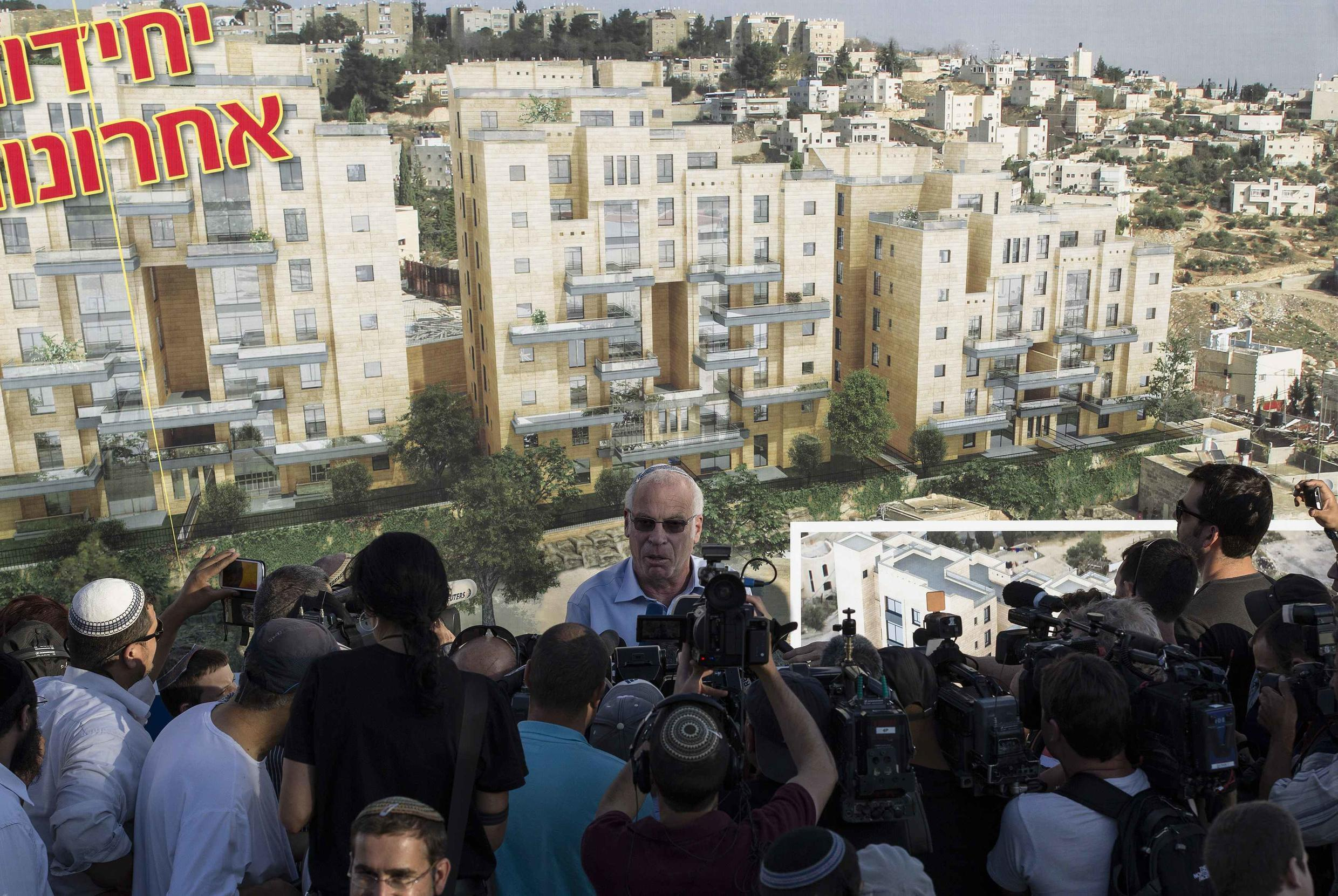 Israeli Housing Minister Uri Ariel announces the plans to build nearly 1,200 new homes for Jewish settlers, 11 August, 2013