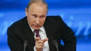 Vladimir Poutine, en conférence de presse, le 18 décembre 2014.