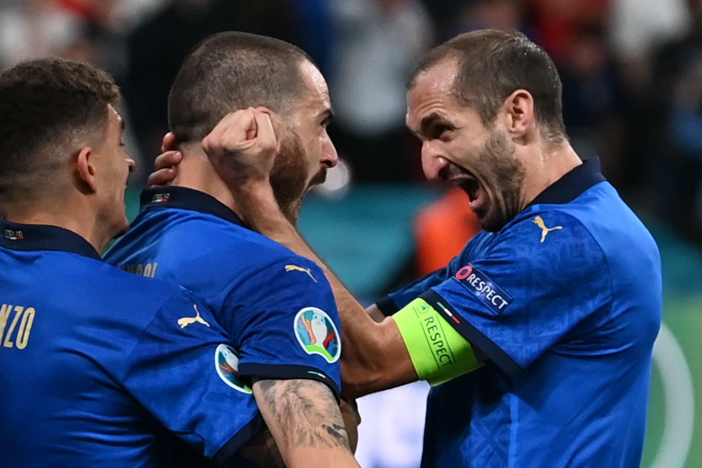 Brothers in arms: Italy's Leonardo Bonucci (centre) celebrates with captain Giorgio Chiellini (right)