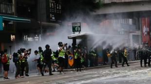 2020-07-01T104607Z_1683562852_RC2AKH90HJBG_RTRMADP_3_HONGKONG-PROTESTS-ANNIVERSARY