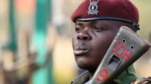 A Kenya General Service Unit policeman stands guard in the area around Westgate shopping mall in Nairobi
