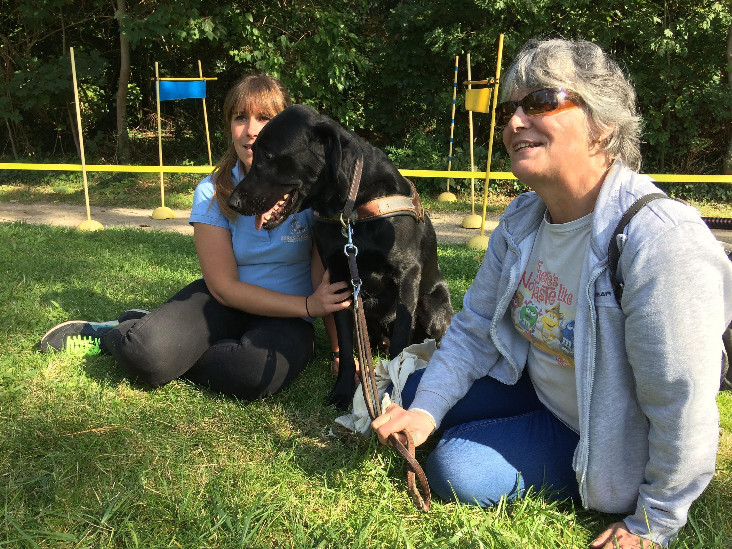 Murielle Le Paysan (right) with her dog Joba and his instructor Emilie at the Paris Guide Dog school