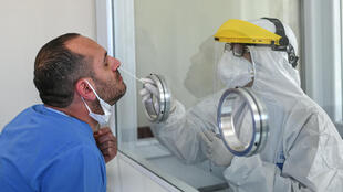 A man being tested for coronavirus.