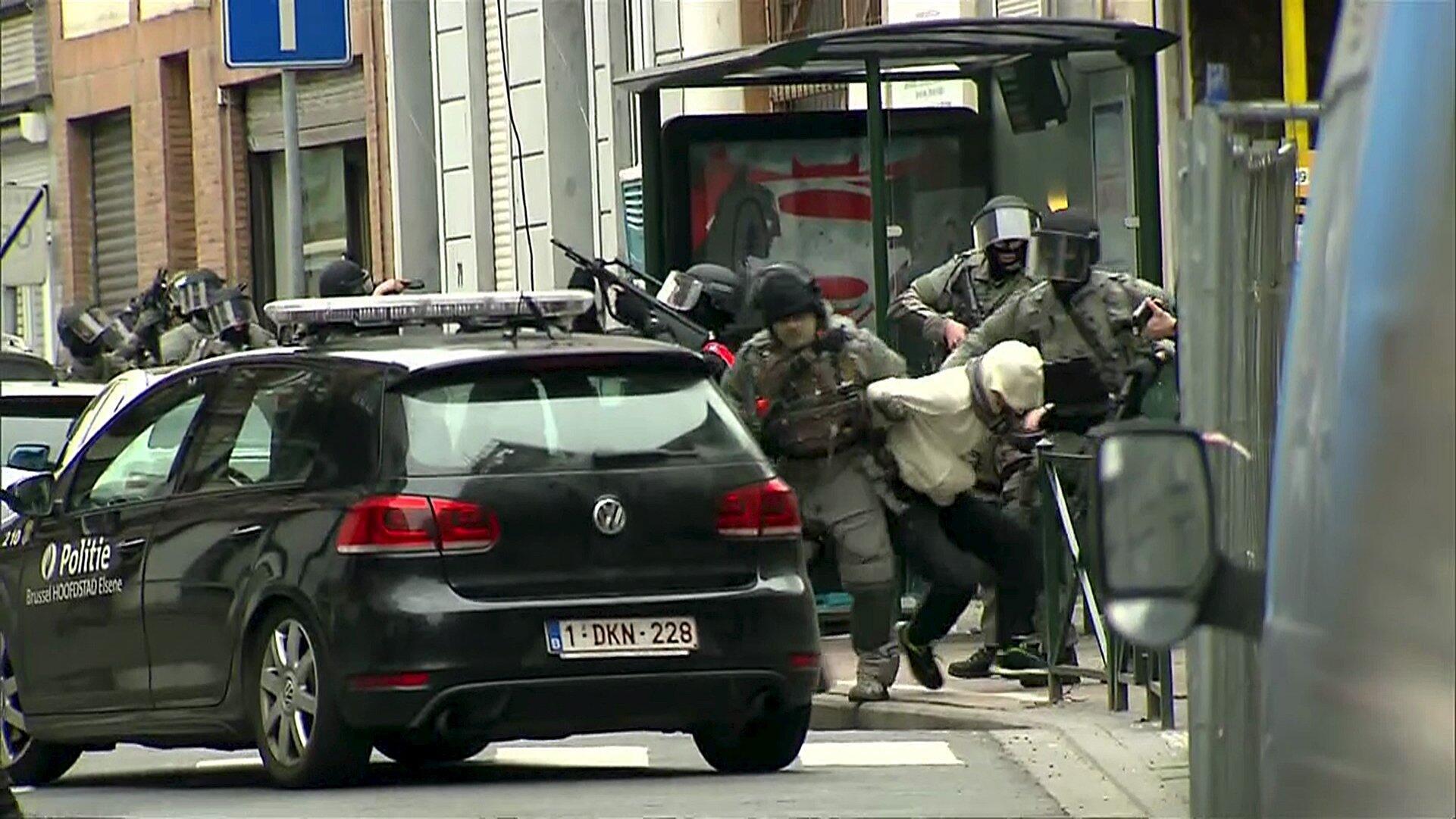 Belgian police arrest Salah Abdeslam, 18 March 2016, in the Molenbeek quarter of Brussels.