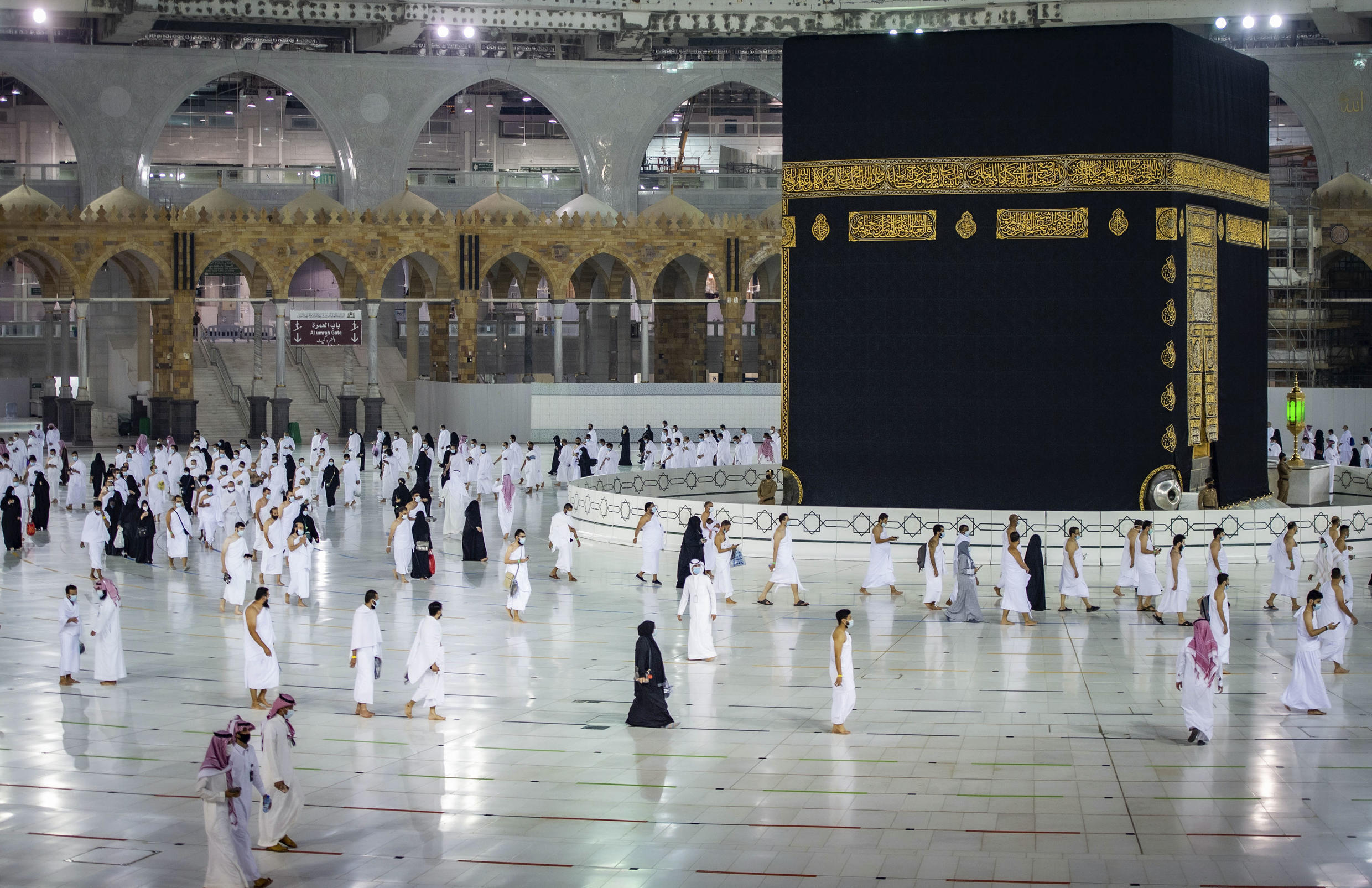 Saudis and foreign residents circumambulate the Kaaba (Tawaf) in the Grand Mosque complex in the Muslimholy city of Mecca