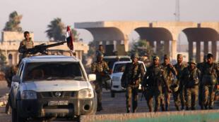 Tropas do exército sírio controlando Nassib, na fronteira com a Jordânia, na província de Deraa, após acordo de 6 de julho de 2018