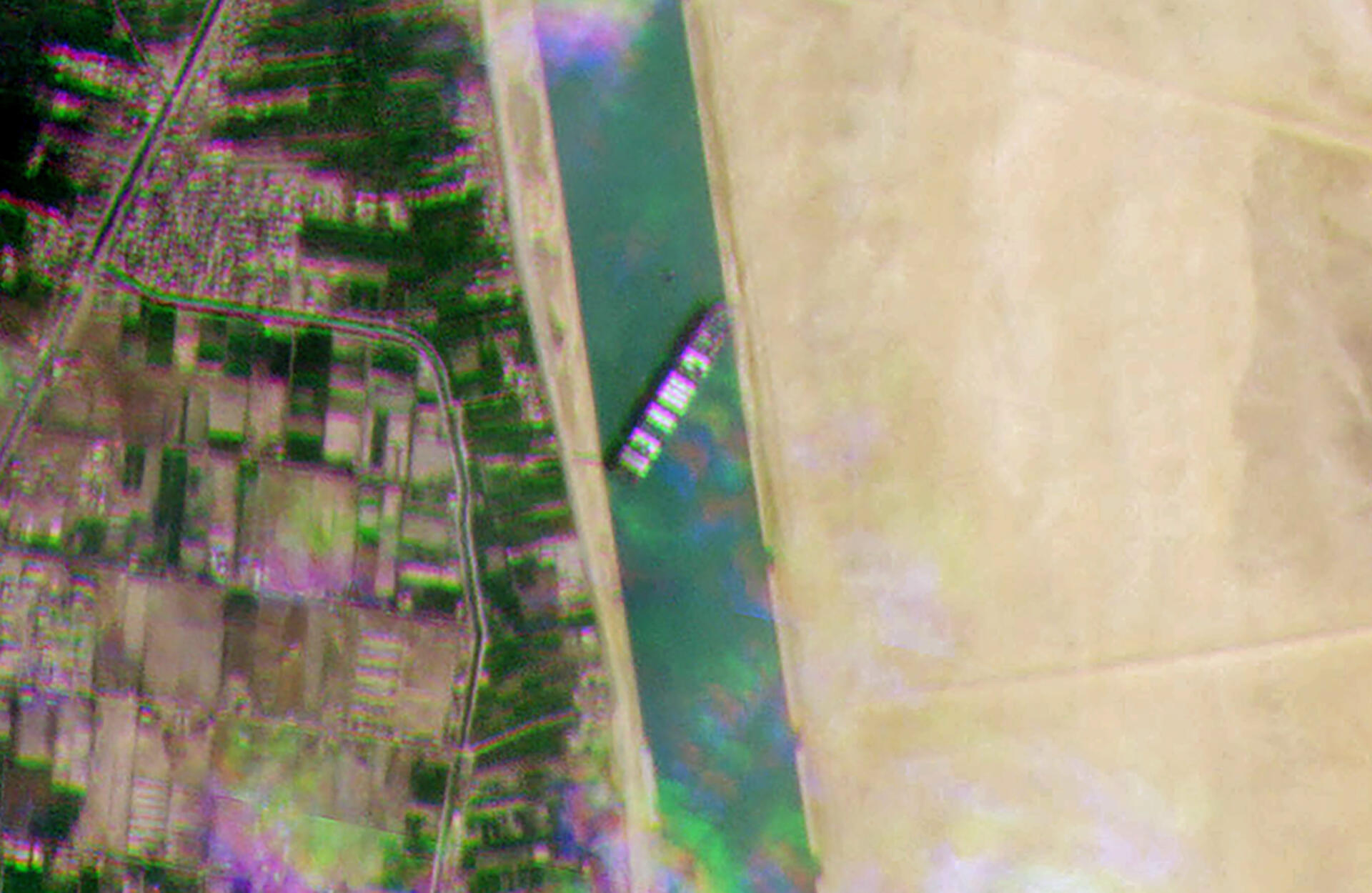 A satellite image released by Planet Labs Inc shows the grounded container ship MV Ever Given blocking all traffic through the main channel of the Suez Canal