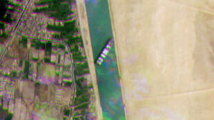 A satellite handout image released by Planet Labs Inc on March 24 shows the MV Ever Given container ship lodged sideways across Egypt's Suez Canal