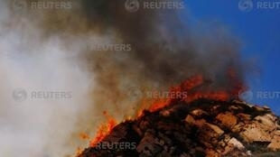 Flames are seen as firefighters battle the Woolsey Fire as it continues to burn in Malibu, California, U.S., November 11, 2018.
