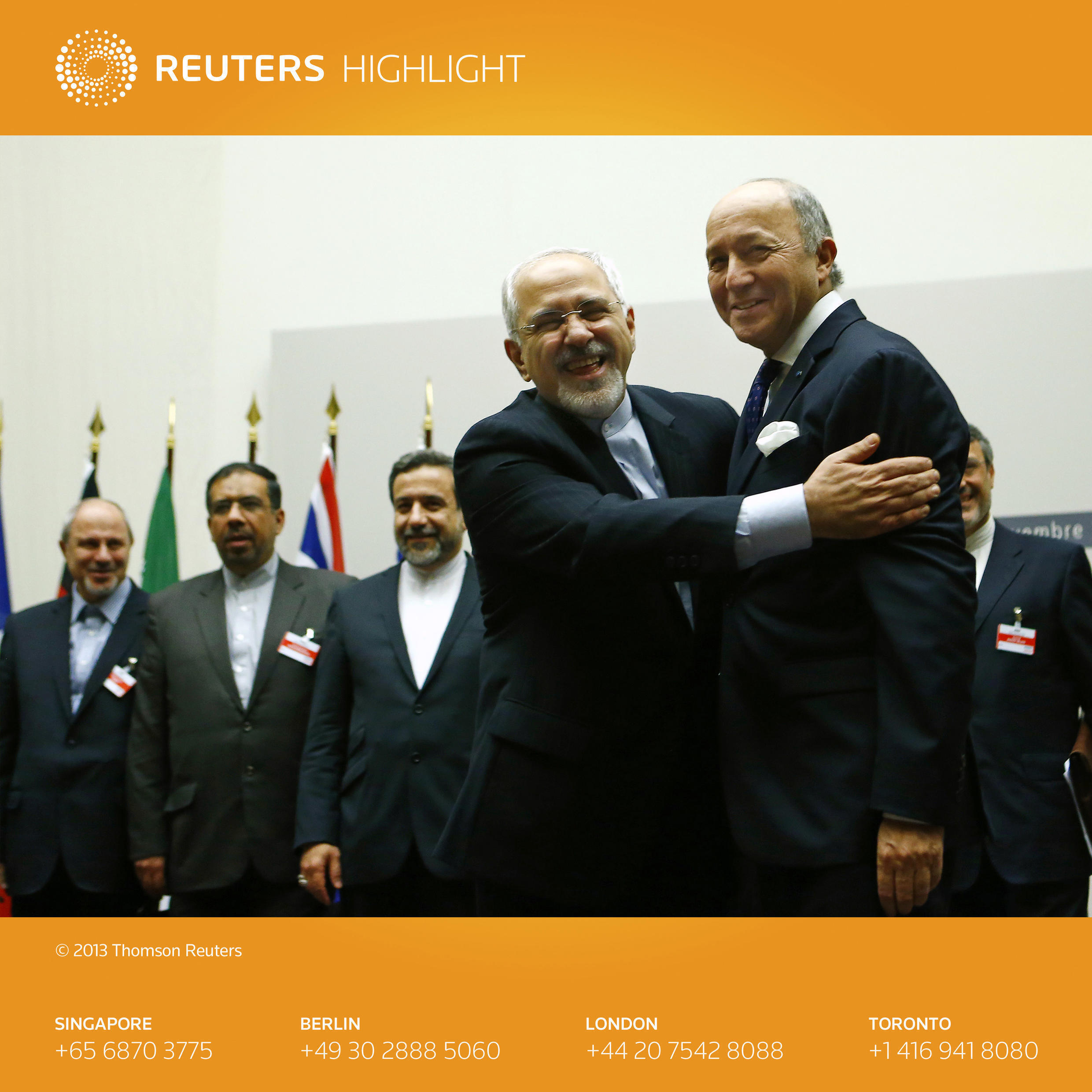 Iranian Foreign Minister Mohammad Javad Zarif hugs French Foreign Minister Laurent Fabius after a ceremony at the United Nations in Geneva
