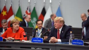 La canciller alemana Angela Merkel y el presidente de Estados Unidos Donald Trump en la cumbre del G20.
