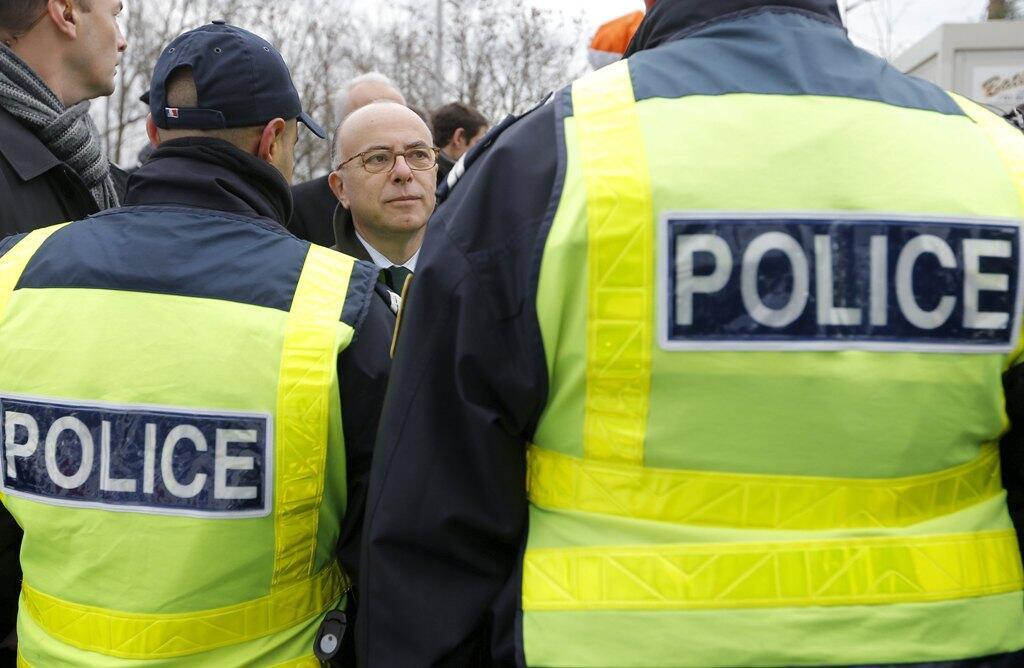 French Interior Minister Bernard Cazeneuve with police officers conducting security control at the French-German border in Strasbourg