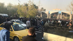People protest near the university of Tehran, Iran December 30, 2017