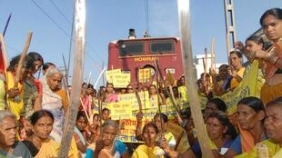 Activists block a train in protest of rising fuel prices in India, 5 July.