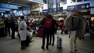 Stranded passangers at Montparnasse train station in Paris on Sunday