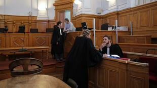 French lawyer Thibaut Kursawa, right, defending retired French surgeon Joel Le Scouarnec attends the opening day of the trial in the courthouse of Saintes, western France, Friday, March 13, 2020. A retired French surgeon accused of raping or sexually abusing more than 300 girls – often on the operating table - goes on trial, in a case that took decades to come to light and may be France's worst single sexual abuse case to date.